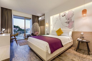 Deluxe Room with Sea View and Jacuzzi - 4 persons | Melanippe Relaxing Hotel