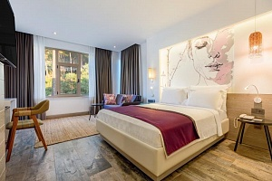 Deluxe Room with Garden View and Jacuzzi - 4 persons | Melanippe Relaxing Hotel